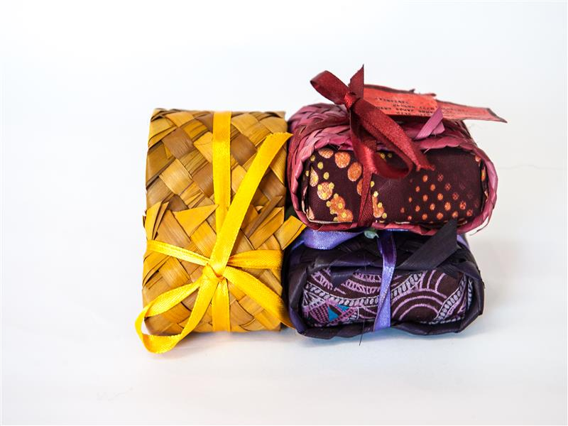 Handmade soap, using only local ingredients; ylang ylang, jasmine, cinammon, sandalwood.  Wrapped in colourful kitenge & hand plaited ukili.