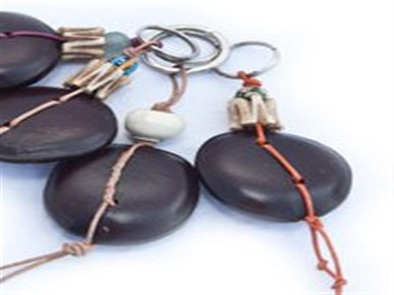 Local Zanzibari baubau seeds with African hand painted ceramic, recycled glass, horn, bone or brass beads, on leather thonging.