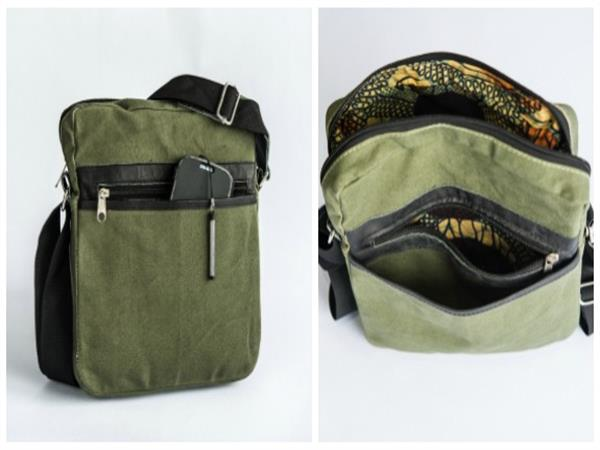 Shoulder bag made from strong locally produced safari tent canvas, with leather external pocket with popper closure and adjustable shoulder strap. Fully li...