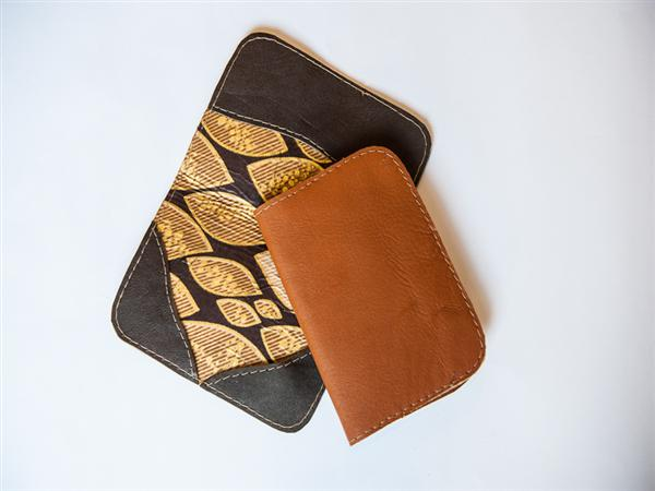 Leather passport holder with kitenge lining/document pocket.