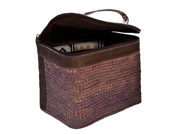 Sturdy vanity box of ukili with leather base, back and top.  Waterproof lining & colourful kitenge pocket. 22 x 18 cm.