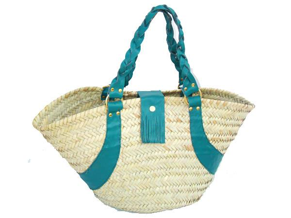 Basket with leather plaited handles and press stud fringed leather closure on leather trim 54 x 30 cm.
