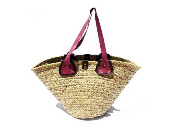 Basket with riveted leather handles & trim, with adjustable press-stud/leather closure tab. 54 x 30 cm.