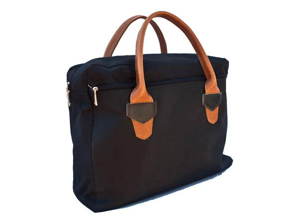 Briefcase available in canvas with leather trim ($145), or all leather (FBCL - $249).    Zipped external document pocket and internal and mobile phone pock...
