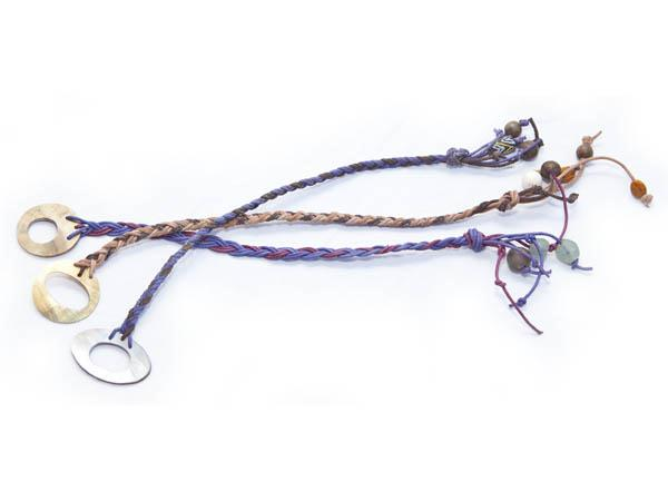 Hand cut cow horn or hand polished oyster shell motif with plaited thongs, embellished with African beads.