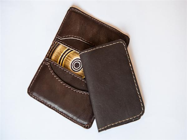 Leather business card/credit card holder with full kitenge lining and four internal pockets.