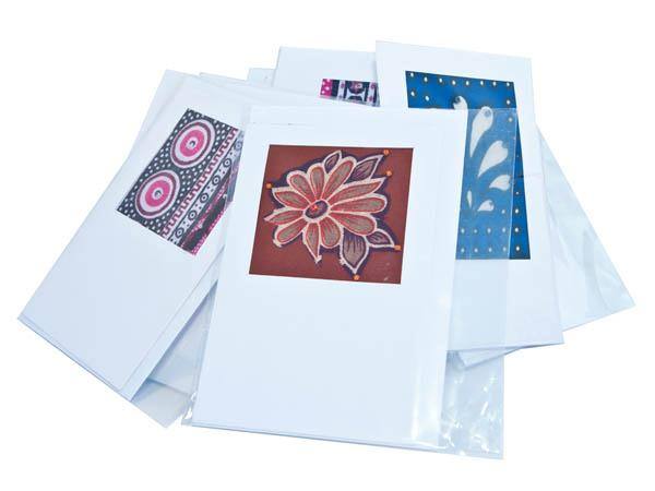 Greeting cards handmade with local colourful kitenge & kanga fabrics - used for generations by Africans to make their clothes.  Decorated with local beads....
