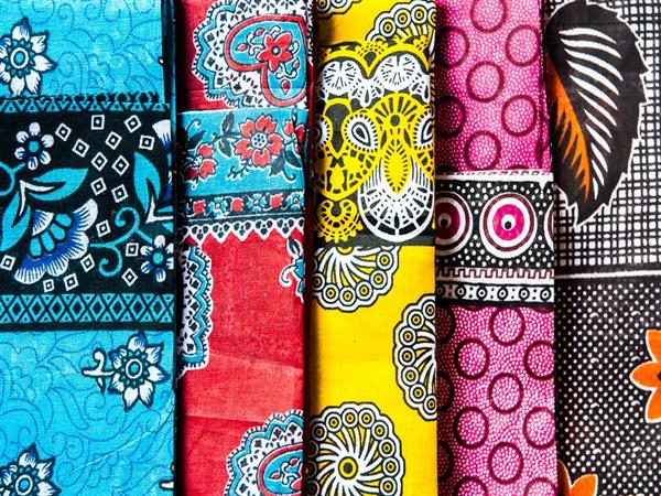 Colourful and vibrant kanga wraps, worn by Swahili women in Zanzibar for centuries.  One worn as a sarong around the lower body, one around the head for mo...