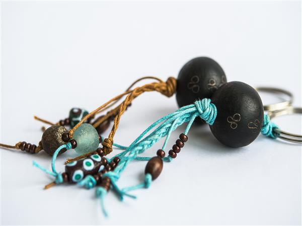 Key ring with African metal, Ebony wood, hand painted ceramic and recycled glass beads, on plaited thronging.