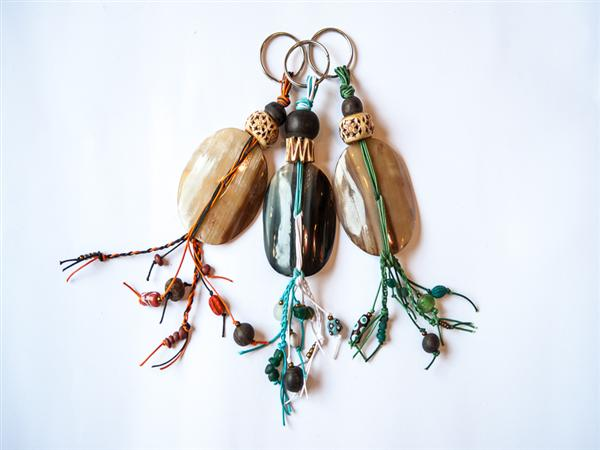 Extra large key ring made from hand cut and polished local cow horn or recycled farmed oyster shell, hand plaited thonging and finished with a variety of A...