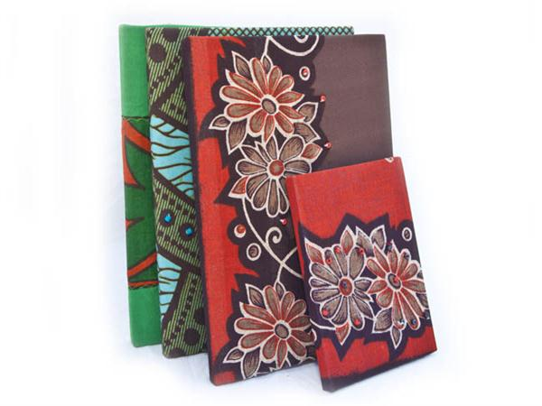 Notebooks bound in local Kitenge fabric and decorated, by hand, with local beads, shells or seeds.  Small Notebook 10 x 15 cm (FNBS $12) .  Large Notebook...