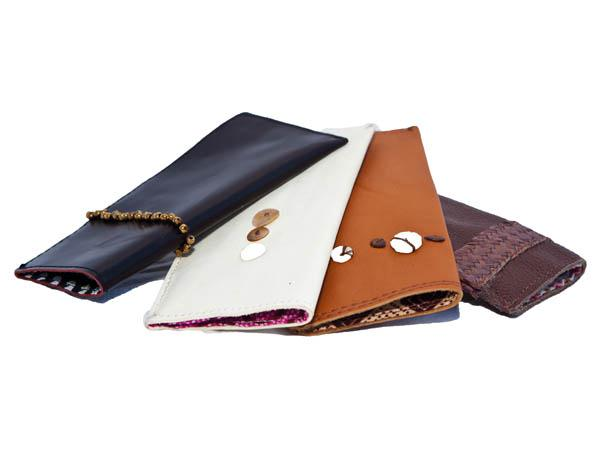 Spectacle & sun-glass cases; plain leather with punched and scored patterns.  Available with plaited ukili strips (FSCU $16) or embellished with African se...