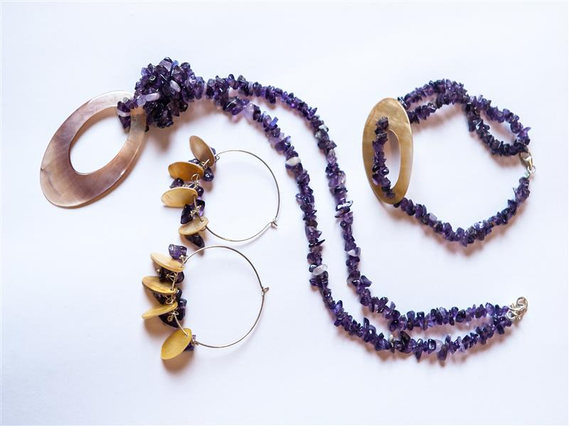 Tanzanian gemstones are the main feature of this collection, and are combined with mother of pearl and sterling silver.  Gemstones available: amethyst (fea...
