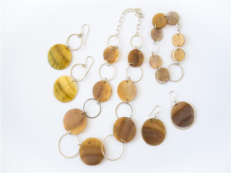 Our jewellers hand form silver hoops, and combine them with mother of pearl discs to create this linked collection.  Necklace (adjustable length): FSN9, $1...