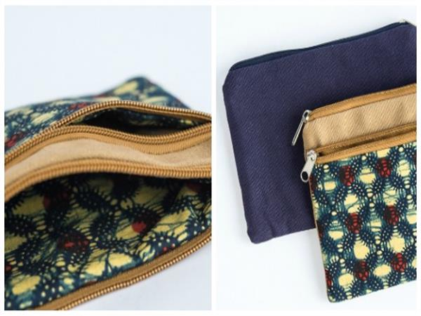 Useful purse, with front zip pocket and a zip closure for security.  Made from safari tent canvas and colourful African kitenges, the purse is fully lined,...