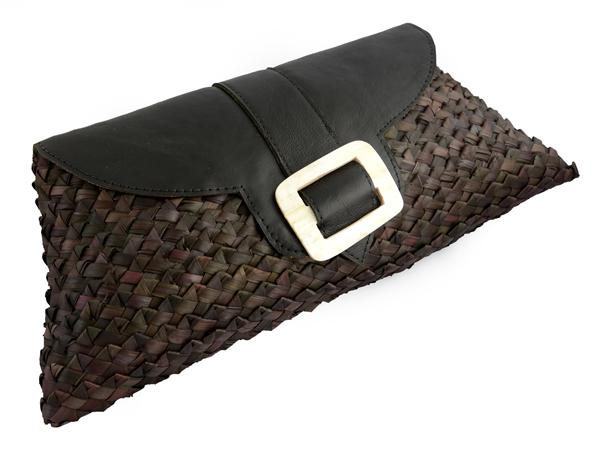 Clutch with hand cut and polished horn based on soft leather flap with magnet closure. 38 x 21 cm.