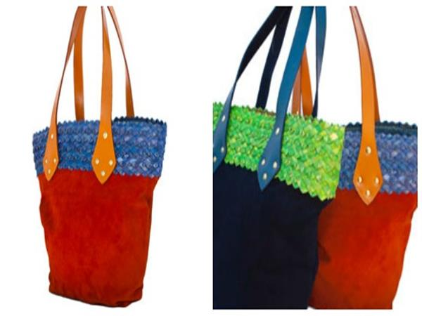 Soft suede leather  shopper with polished leather handles, plaited ukili trim.  Full kitenge lining, including pouch and mobile phone pockets.  24 x 36 cm.