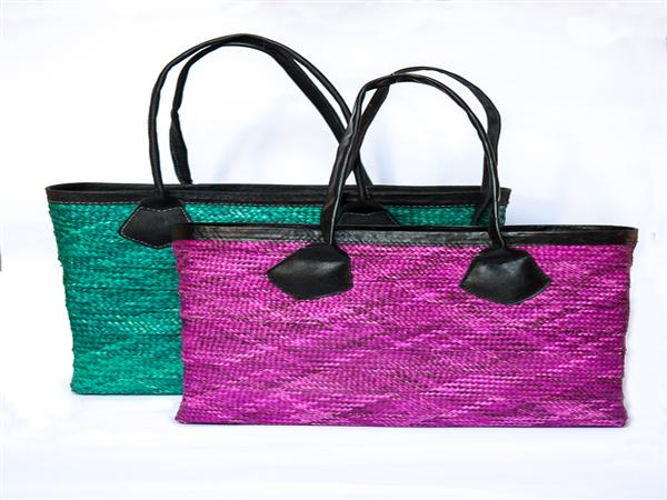 Stunning clutch bag made from ukili (local palm leaf, hand dyed and plaited, and formed into a bag), trimmed with local leather and fully lined with Africa...